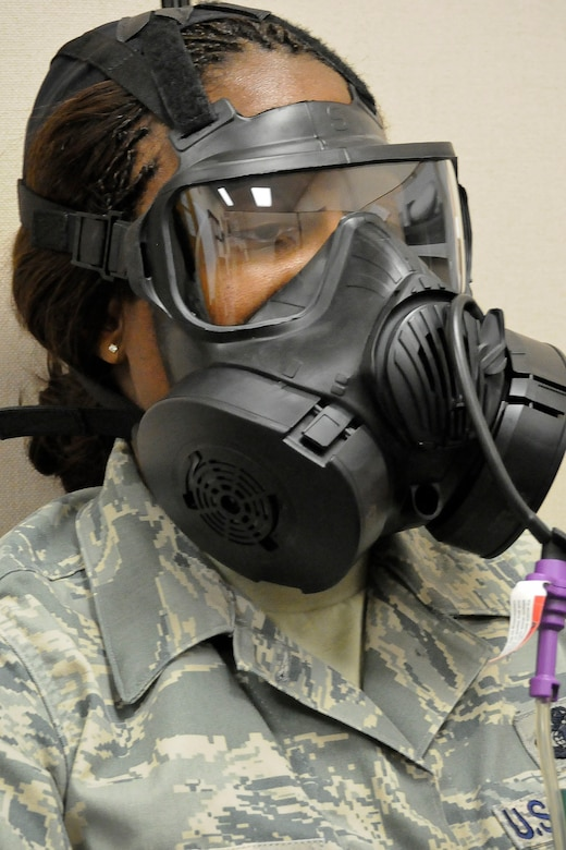 """Master Sgt. Leslie Koger of the 245th Air Traffic Control Squadron, McEntire Joint National Guard Base, S.C., patiently completes her new M-50 gas mask """"fit test"""", Oct. 18, 2012.  (National Guard photo by Master Sgt. Marvin R. Preston/Released)"""