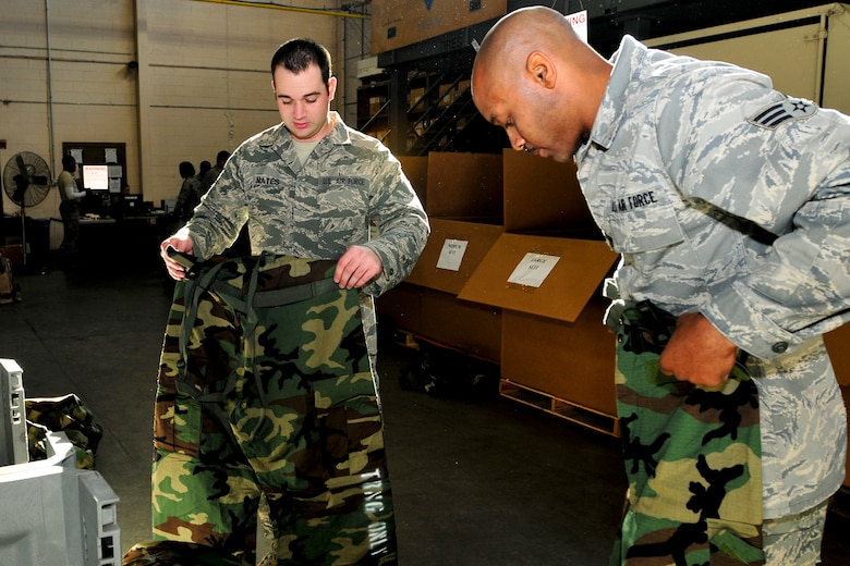 Senior Airmen Anthony Fields and Johnny Nates, 169th Maintenance Squardon, check for proper fit of thier new Joint Service Lightweight Integrated Suit Technology (JLIST), McEntire Joint National Guard Base, S.C., Oct. 13, 2012.  The old Battle Dress Overgarment (BDO) and gas mask are being phased out to introduce the new JLIST and M50 before the wing begins training for their Operation Readiness Inspection. (National Guard photo by Staff Sgt. Jorge Intriago/Released)
