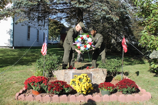 Lt. Col William Wando, a student at the Naval War College, and Capt. Cavan Croskey, Aviation Logistics Tactical Information Officer in Charge at the Aviation Logistics School, Marine Corps Detachment Newport, Naval Station Newport, place the wreath behind the Portmsouth Beirut Memorial in Portsmouth, R.I. following a ceremony held this morning at the site.  The memorial specifically honors the 9 Rhode Island Marines who died 29 years ago today in the bombing.