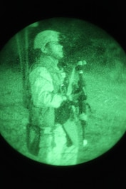 A squad leader with Combat Logistics Battalion 11, Combat Logistics Regiment 17, 1st Marine Logistics Group, stands guard during a night  operation at Camp Pendleton, Calif., Oct. 18. During the Basic Combat Skills Course, instructors with the Combat Skills Training School offer classes and field operations to improve the combat readiness for multiple non-infantry units.