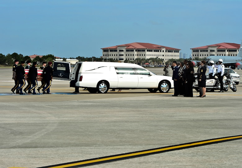 The remains of Spc. Brittany B. Gordon are carried by Army honor guardsmen to a hearse at MacDill Air Force Base Fla., Oct. 24, 2012. Gordon died from wounds suffered by an attack with an improvised explosive device on Oct. 13 in Kandahar, Afghanistan, she was assigned to Joint Base Lewis-McChord, Wash. (U.S. Air Force photo by Airman 1st Class Melanie Bulow-Kelly/Released)