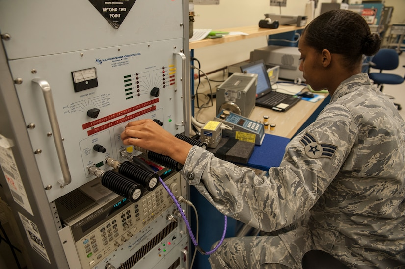Staff Sgt. Christopher Hutchison, 437th Maintenance Squadron Precision Measurement Equipment Laboratory section supervisor for the K-3 microwave measurement section, looks at a circuit card at the Electrostatic discharge/Sautering station Oct. 16, 2012 at Joint Base Charleston - Air Base, S.C. The ESD/Sautering troubleshoots down to the component level on a circuit card. (U.S. Air Force photo/Airman 1st Class Ashlee Galloway)