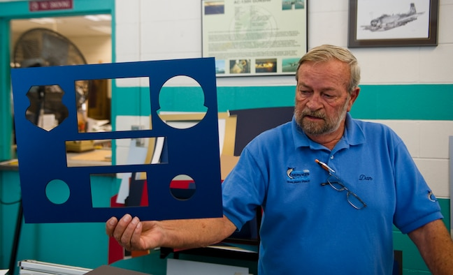 Dan Ruddell, manager of The Frame shop, holds up a final foam-board cut out that he just finished working on at The Frame Shop on Hurlburt Field, Fla., Oct. 12, 2012. The frame shop comes equipped with metal and wood frames in a large selection of materials and colors, foam-core back-boards, frame hardware and a variety of glass which includes standard and non-glare glass. (U.S. Air Force photo/Airman 1st Class Christopher Williams)