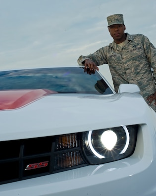 U.S. Air Force Staff Sgt. Dwayne Hopkins, a unit deployment manager with 1st Special Operations Logistics Readiness Squadron, stands next to his Camaro SS on Hurlburt Field Fla., Oct. 3, 2012. He is a member of the Airman to Airman Saftey Advisory Council; Hopkins has been briefing a safety message based on the lessons he learned after a motorcycle accident. (U.S. Air Force Photo / Staff Sgt. John Bainter)