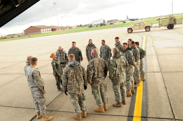 The operational company of the 42nd Infantry Division of the Army National Guard arrived ready to train with the 107th Airlift Wing's C-130 loadmasters. Senior Master Sgt. Santoro explains how the equipment will be loaded and secured on the C-130 aircraft. Oct. 20, 2012 (U.S. Air Force Photo/Senior Master Sgt. Ray Lloyd)