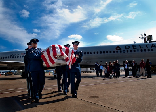 U.S. Air Force Honor Guard members carry the remains of Col. Wendell Keller, of Fargo N.D. and Capt.Virgil K. Meroney, of Fayetteville, Ark., at Ronald Reagan Washington National Airport Oct. 18, 2012. Family members were present at the arrival. March 1, 1969, Keller and Meroney were the crew of an F-4D Phantom II aircraft that went down while carrying out a night time strike mission in Khammouan Province, Laos. Nearby aircrews reported seeing the aircraft hit by enemy fire. No parachutes were seen after the aircraft was hit. Heavy enemy presence in the area prevented recovery efforts.   (U.S. Air Force photo/Master Sgt. Cecilio Ricardo)