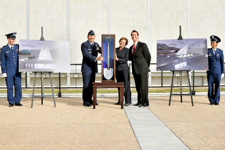 Air Force Academy Superintendent Lt. Gen. Mike Gould (second from left) unveils one of the ceremonial shovels that will be used for groundbreaking of the Air Force Academy's Center for Character and Leadership Development facility. The new facility, scheduled to be finished in 2014, was made possible through $30 million in annual military construction budget funds and $10 million in private donations. (U.S. Air Force photo/Liz Copan)
