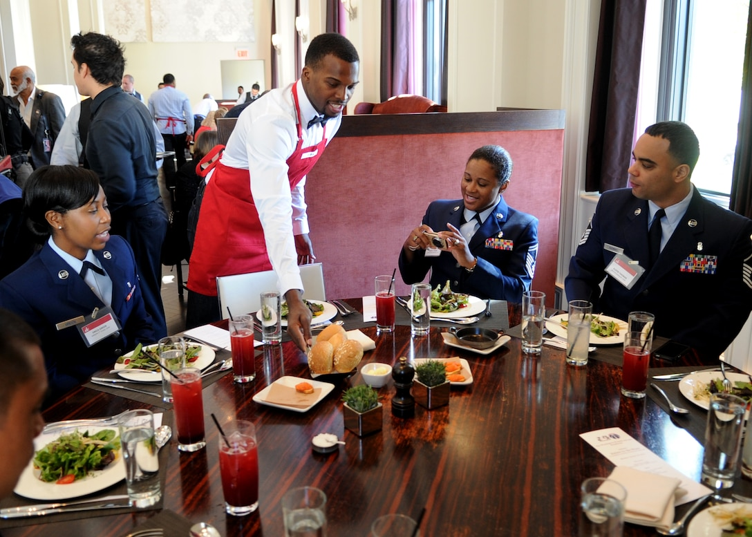 Shelvin Mack, Washington Wizards point guard, serves Airmen from the 79th Medical Wing, Joint Base Andrews, Md., during the 3rd Annual Salute to the Stars luncheon at in Washington, D.C., Oct. 22, 2012. During the luncheon the service members and their families were served a complementary four course meal. (U.S. Air Force photo/ Staff Sgt. Nichelle Anderson)