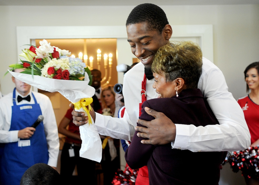 Jordan Crawford, Washington Wizards shooting guard, hugs Janice Chance, the mother of Marine Capt. Jesse Melton III, during the  3rd Annual Salute to the Stars luncheon in Washington, D.C., Oct. 22, 2012. Melton was killed in action Sept. 9, 2008, in support of combat operations in Afghanistan. (U.S. Air Force photo/Staff Sgt. Nichelle Anderson)