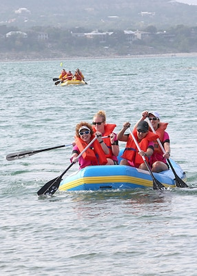 X-treme team Road Divas members, (from left to right), Kimberly Felty, Carolina Marin Solo, Johanna House and Jennifer Mitchell, row during the 2-mile rafting course as part of the Rambler 120 competition Oct. 20 at the Joint Base San Antonio Recreation Park at Canyon Lake.