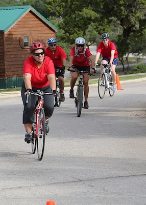 Team Kick Rx members (from left to right), Kimberly Ortmeyer, Carlos Martinez, Oriana Davila, and Justin Lusk, compete with 36 other teams in the 22-mile bike race portion of the seventh annual Rambler 120 Competition Oct 20 at Joint Base San Antonio Recreation Park at Canyon Lake.  The endurance portion event included running, cycling, rowing and a mystery event.