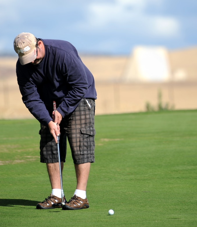 Donald Payne, 9th Force Support Squadron performs a putt during the Intramural Golf Championships at the Coyote Run Golf Course Beale Air Force Base, Calif., Oct. 23, 2012. The 9th FSS was defeated by the 13th Intelligence Squadron. (U.S. Air Force photo by Staff Sgt. Robert M. Trujillo/Released)