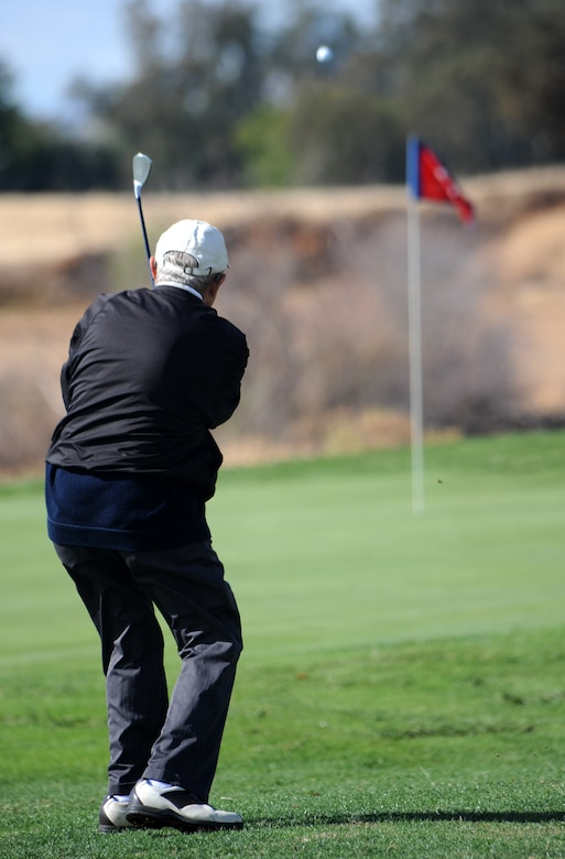 Jim Callahan, 9th Force Support Squadron, performs a chip shot during the Intramural Golf Championships at the Coyote Run Golf Course Beale Air Force Base, Calif., Oct. 23, 2012. Callahan's shot landed mere inches from the hole. (U.S. Air Force photo by Staff Sgt. Robert M. Trujillo/Released)