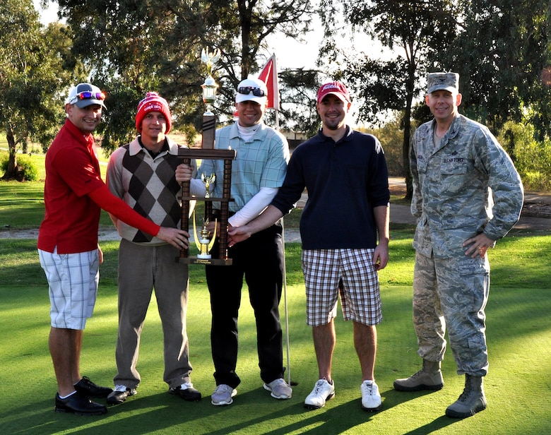 Col. Jason Green, 9th Mission Support Group commander, present members of 13th Intelligence Squadron the Intramural Golf Championship trophy at Coyote Run Golf Course Beale Air Force Base, Calif., Oct. 23, 2012. The 13th IS defeated the 9th Force Support Squadron at 18 holes of match-play golf. (U.S. Air Force photo by Staff Sgt. Robert M. Trujillo/Released)