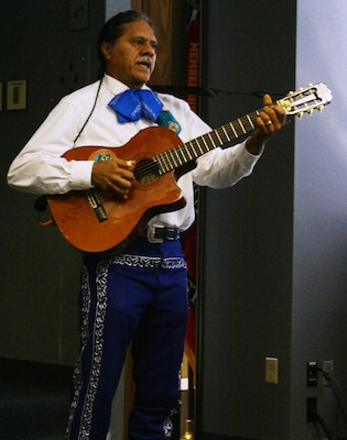 Jorge Rodriguez entertains attendees to the Hispanic History program held at the Tulsa District headquarters.