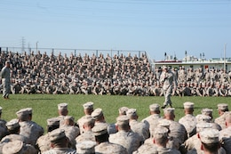 """Lt. Gen. Kenneth J. Glueck, Jr. addresses Marines, sailors and civilians during an all-hands period of reflection brief at Camp Foster Oct. 25. """"I have all the trust and confidence that we will overcome this period and continue to move forward,"""" said Glueck. """"Every Marine on Okinawa became a diplomat the moment they landed on Okinawa. Conduct yourselves accordingly when interacting with our hosts and be the best diplomat you can be for our country and service."""" Glueck plans to visit all Marine installations on island within the week to address recent alleged sexual assault incidents and the resulting liberty policy changes while emphasizing the role of service members as ambassadors on Okinawa. Glueck is the III Marine Expeditionary Force commanding general."""
