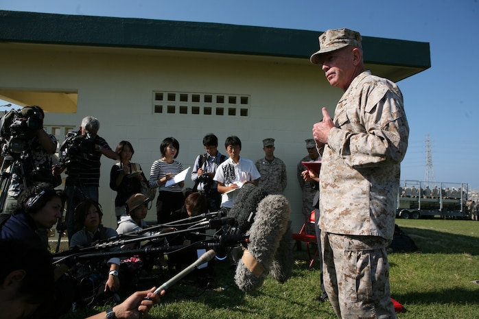 "Lt. Gen. Kenneth J. Glueck, Jr. addresses Okinawan media during an all-hands period of reflection brief at Camp Foster, Okinawa, Japan Oct. 25. ""I have all the trust and confidence that we will overcome this period and continue to move forward,"" said Glueck. ""Every Marine on Okinawa became a diplomat the moment they landed on Okinawa. Conduct yourselves accordingly when interacting with our hosts and be the best diplomat you can be for our country and service."" Glueck plans to visit all Marine installations on island within the week to address recent alleged sexual assault incidents and the resulting liberty policy changes while emphasizing the role of service members as ambassadors on Okinawa. Glueck is the III Marine Expeditionary Force commanding general."