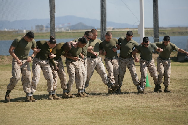 A Gladiator's Cup challenge team competes in the ten-legged race during the Commander's Cup's final event, the Gladiator Cup challenge, which took place at Penny Lake fields here Oct. 19, 2012. The Gladiator's Cup was an all-day, multi-disciplined evolution and teams received points based on their placement in each event. At the end of the day, officials totaled each team's points for the day to decide the victor.