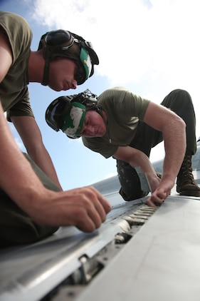 Cpl. Joseph S. Lorenzen, a Marine All-Weather Fighter Attack Squadron 225 F/A-18D Hornet airframes mechanic, and Sgt. Frank Gottardo, VMFA(AW)-225 F/A-18D Hornet airframes quality assurance representative and mechanic, troubleshoot a VMFA(AW)-225 F/A-18D Hornet during Exercise Island Fury aboard Andersen Air Force Base Oct. 19. Island Fury is a month-long exercise, which began early October.