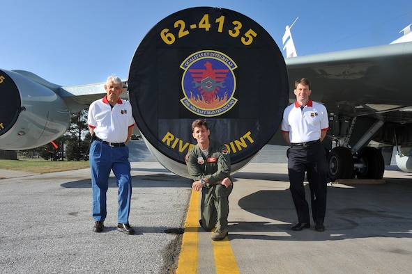 The Eldridge family, retired U.S. Air Force Lt. Col. Golda T. Eldridge Sr. (Left), U.S. Air Force 1st Lt. Joshua Eldridge (Center) and retired U.S. Air Force Lt. Col. Golda T. Eldridge Jr. (Right) stand next to an RC-135V/W Rivet Joint. The Eldridge family is the first to have a third generation pilot become part of the 55th Wing at Offutt Air Force Base.