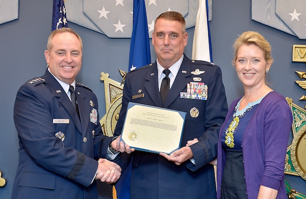 Air Force Chief of Staff Gen. Mark A. Welsh III presents the 2012 General Jerome F. O'Malley and Diane O'Malley Award to Col. Michael Minihan and his wife, Ashley, during a ceremony at the Pentagon, Oct. 24, 2012. The Minihans earned the award for their time in command at Little Rock Air Force Base, Ark. The annual award recognizes the wing commander and spouse team whose contributions to the nation, Air Force, and local community best exemplify the highest ideals and positive leadership of a military couple in a key Air Force position. (U.S. Air Force photo/Michael J. Pausic)