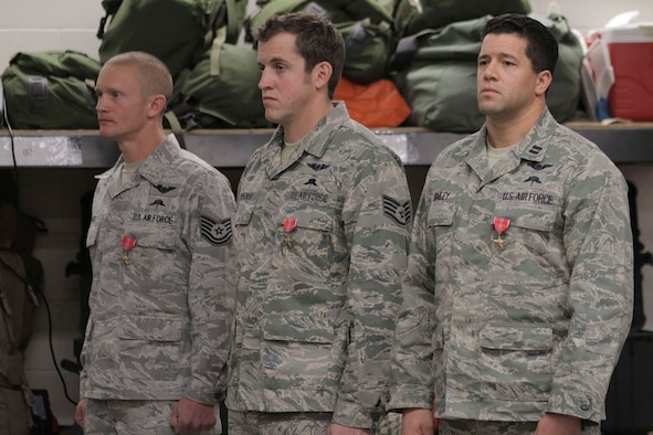 Tech. Sgt. Shane J. Hargis, Air Force Staff Sgt. Theodore M. Sierocinski and Capt. Koaalii C. Bailey stand during a Oct. 13 ceremony after they received the Bronze Star Medal with Valor device. (Alaska National Guard photo/Air Force Maj. Guy Hayes)