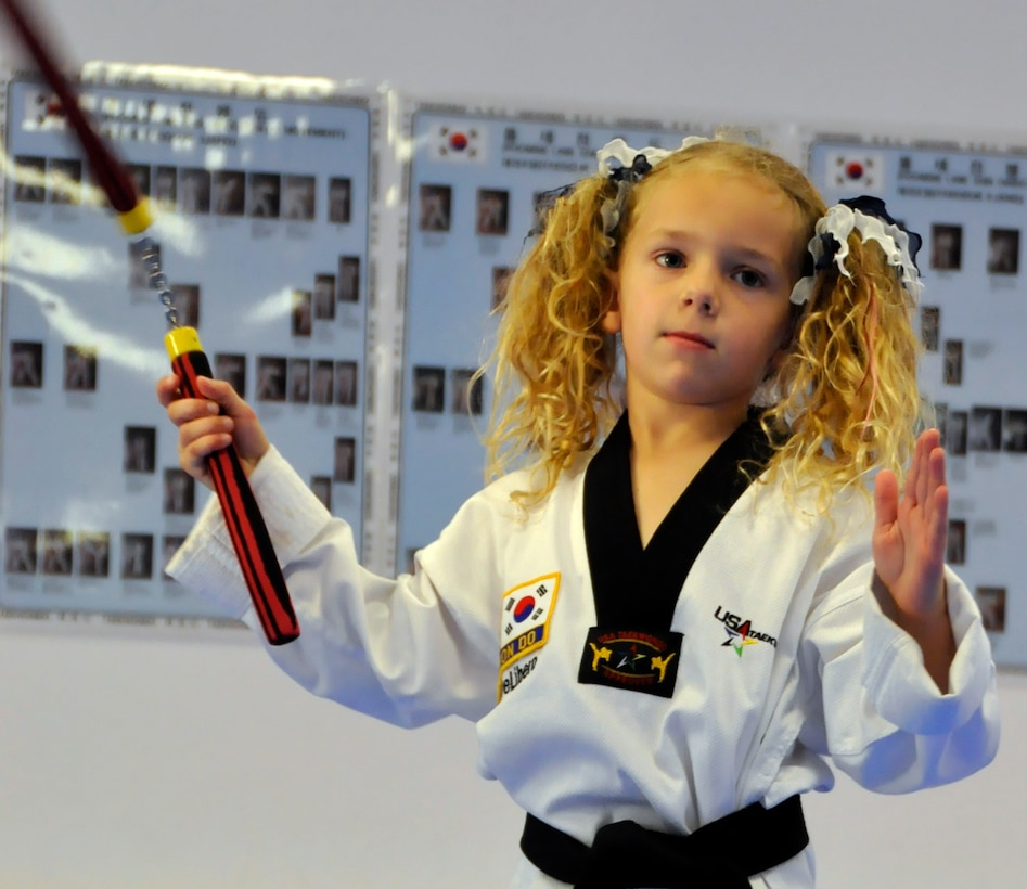 Sidney DeLibero, daughter of a 446th Airlift Wing Reservist, practices with nunchucks at a taekwondo school in Edgewood, Wash., Oct. 17. DiLibero became the world's youngest taekwondo black belt, at age 6, Sept. 20. (U.S. Air Force Photo/Staff Sgt. Rachael Garneau)