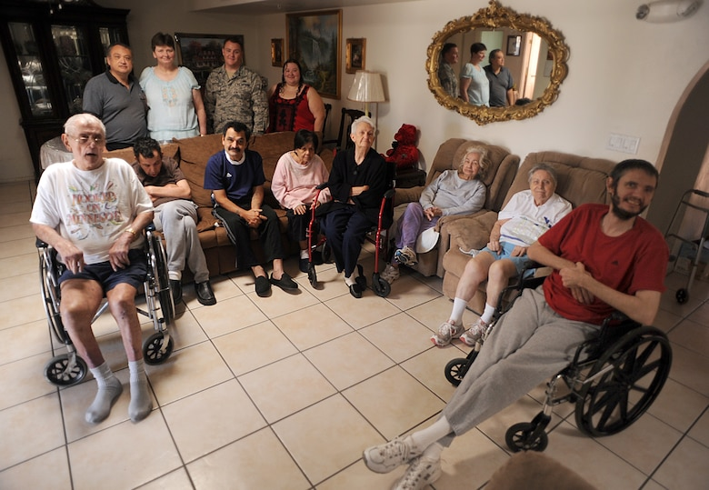 U.S. Air Force Staff Sgt. Christopher Cacopardo, 923rd Aircraft Maintenance Squadron, poses for a photo with residents he saved in Tucson, Ariz., Oct. 25, 2012. Sergeant Cacopardo pulled the residents from the house after the garage caught fire. (U.S. Air Force photo by Airman 1st Class Christine Griffiths/Released)