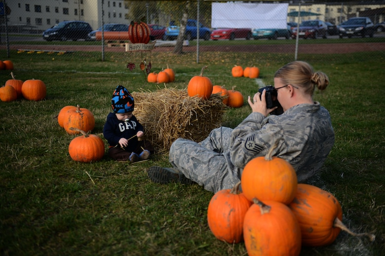 SPANGDAHLEM AIR BASE, Germany – U.S. Air Force Staff Sgt. Wendy Dupre, 52nd Communications Squadron client systems evaluator from Douglas, Ga., takes a photo of her son Maddox in a soccer field near the child development center during a pumpkin patch event Oct. 25, 2012.  The event encouraged a learning experience for the children through active parent involvement while incorporating the Halloween spirit. (U.S. Air Force photo by Airman 1st Class Gustavo Castillo/Released)
