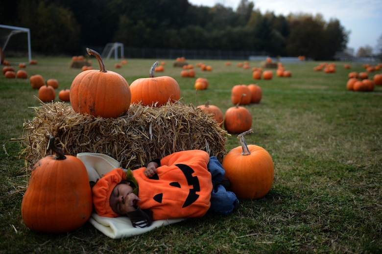 SPANGDAHLEM AIR BASE, Germany – Jonathan Barker, son of Staff Sgt. Mychel and Senior Airman Jasmine Barker, takes a nap in a field of pumpkins near the child development center during a pumpkin patch event Oct. 25, 2012.  The 52nd Force Support Squadron Airman and Family Services Flight sponsor this event to give back to 52nd Fighter Wing families in preparation for the holidays. (U.S. Air Force photo by Airman 1st Class Gustavo Castillo/Released)