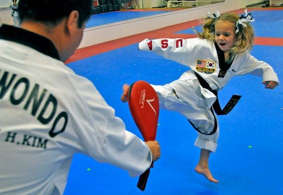 Sidney DeLibero, daughter of a 446th Airlift Wing Reservist, practices her kick at a taekwondo school in Edgewood, Wash., Oct. 17. DiLibero became the world's youngest taekwondo black belt at 6 years old Sept. 20, according to the World Taekwondo Headquarters in South Korea. (U.S. Air Force Photo/Staff Sgt. Rachael Garneau)