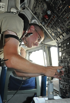 SOUTHWEST ASIA - U.S. Air Force Senior Airman Daniel Phelps, 380th Expeditionary Aircraft Maintenance Squadron guidance and control technician, exchangesa fuel quantity indicator on an E-3 Sentry before a 970th Expeditionary Airborne Air Control Squadron training flight Oct. 24, 2012. Seven of the eight E-3 crews here come from Tinker Air Force Base, Okla., along with support personnel including aircraft maintainers. (U.S. Air Force photo/Tech. Sgt. Amanda Savannah)