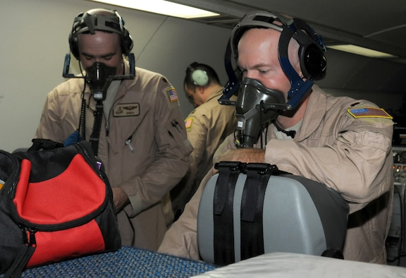 SOUTHWEST ASIA - U.S. Air Force Majs. Ryan Ough, 970th Expeditionary Airborne Air Control Squadron senior director, and Victor Walk, 970th EAACS air surveillance officer, test their oxygen masks on board an E-3 Sentry before a training flight Oct. 24, 2012. The 970th EAACS here currently consists primarily of Airmen from its home station, Tinker Air Force Base, Okla. (U.S. Air Force photo/Tech. Sgt. Amanda Savannah)