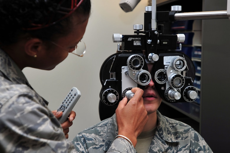 Capt. Felicia Jackson, 51st Aerospace Medicine Squadron Optometry Flight optometrist, conducts an eye exam at Osan Air Base, Republic of Korea, Oct. 24, 2012. The optometry flight provides optic care for the base populous keeping everyone fit to fight. The team of four includes two optometrists and two ophthalmic technicians. (U.S. Air Force photo/Airman 1st Class Alexis Siekert)
