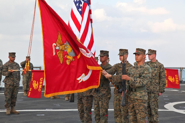 The color guard for Combat Logistics Battalion 15, 15th Marine Expeditionary Unit, presents their unit's battle colors to be rededicated during the CLB's 25th birthday aboard the USS Rushmore, Oct. 15. The 15th MEU along with the Peleliu Amphibious Ready Group, which includes the USS Rushmore, USS Peleliu and USS Green Bay, is currently deployed to the Western Pacific.