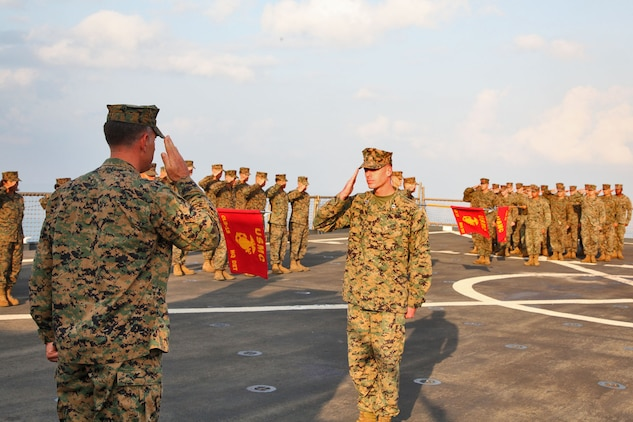 Lieutenant Col. John Wiener (left), commanding officer, Combat Logistics Battalion 15, 15th Marine Expeditionary Unit, returns a salute during the CLB's 25th birthday aboard the USS Rushmore, Oct. 15. The 15th MEU along with the Peleliu Amphibious Ready Group, which includes the USS Rushmore, USS Peleliu and USS Green Bay, is currently deployed to the Western Pacific.