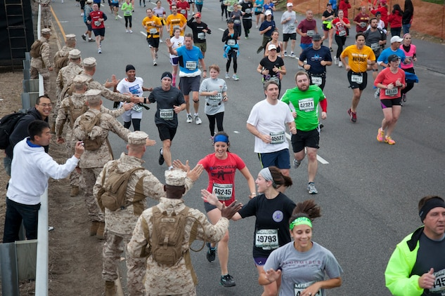 Marine volunteers cheer on runners during the Marine Corps Marathon 10k Oct. 28. The 10k started at the corner of 12th and Madison on the National Mall and ended just before the Iwo Jima Memorial