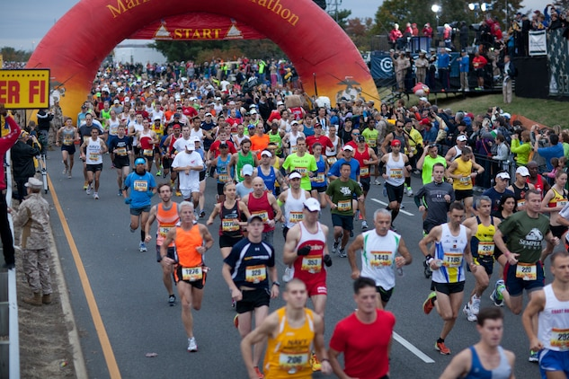 Runners start their 26.2-mile trek through the streets of Washington during the 37th Marine Corps Marathon Oct. 28 at the boom of the 105mm Howitzer. The 37th MCM enjoyed its largest number of starters to date with 23,864 people, from across the world, who came to reach their 26.2-mile goal despite an impending hurricane.