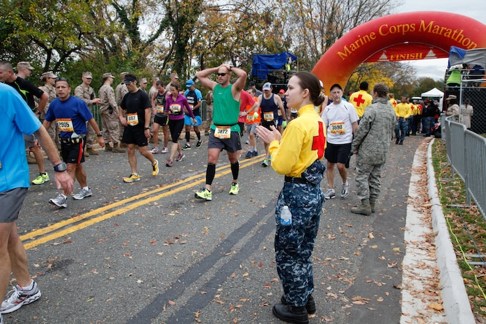 Navy corpsmen wait nearby for runners with injuries or illnesses at the finish line of the 37th Marine Corps Marathon Oct. 28. Medical stations manned by civilian and military practitioners were set up throughout the 26.2-mile course.