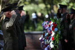 Marines salute wreaths being laid in remembrance of the service members who lost their lives in the Beirut bombing during the Beirut Memorial Service Ceremony in Jacksonville, N.C., Oct. 23. There were three wreaths laid at the event: one to honor the connection between the Jacksonville and Marine Corps Base Camp Lejeune communities, one to pay respect to the Marines and sailors who died during the attack and were a part of the community, and one representing the Marines of 1st Battalion, 8th Marine Regiment, 2nd Marine Division, of which many of the fallen Marines belonged to.
