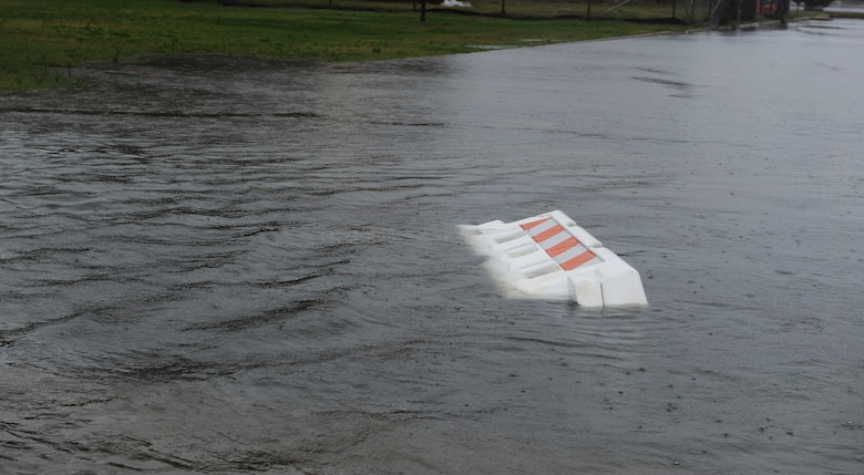 A plastic barrier floats down Bowen Street at Langley Air Force Base, Va., Oct. 29, 2012. Hurricane Sandy, a category one storm, caused extensive flooding but minimal physical damage to base facilities. (U.S. Air Force photo by Airman 1st Class Teresa Aber/Released)
