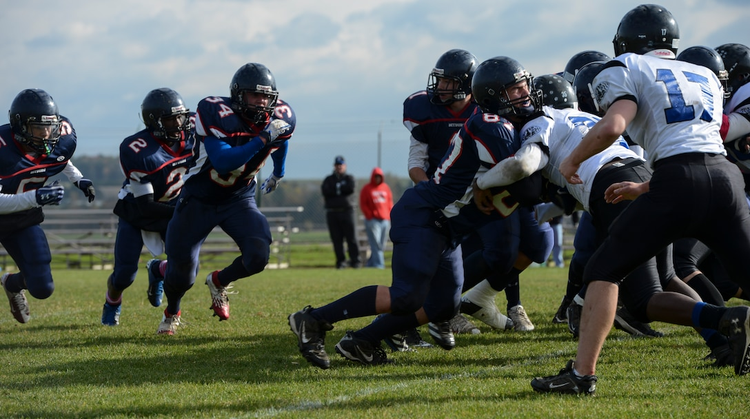 BITBURG ANNEX, Germany -- Bitburg Barons rush the line against Hohenfels Tigers during the Barons' last home game Oct. 27, 2012, at the Rik Carr Field. The undefeated Barons won 56-14. The Barons play in the Division-II championship game, which will be streamed live by American Forces Network 2:30 p.m., Nov. 3, 2012. (U.S. Air Force photo by Senior Airman Natasha Stannard/Released)