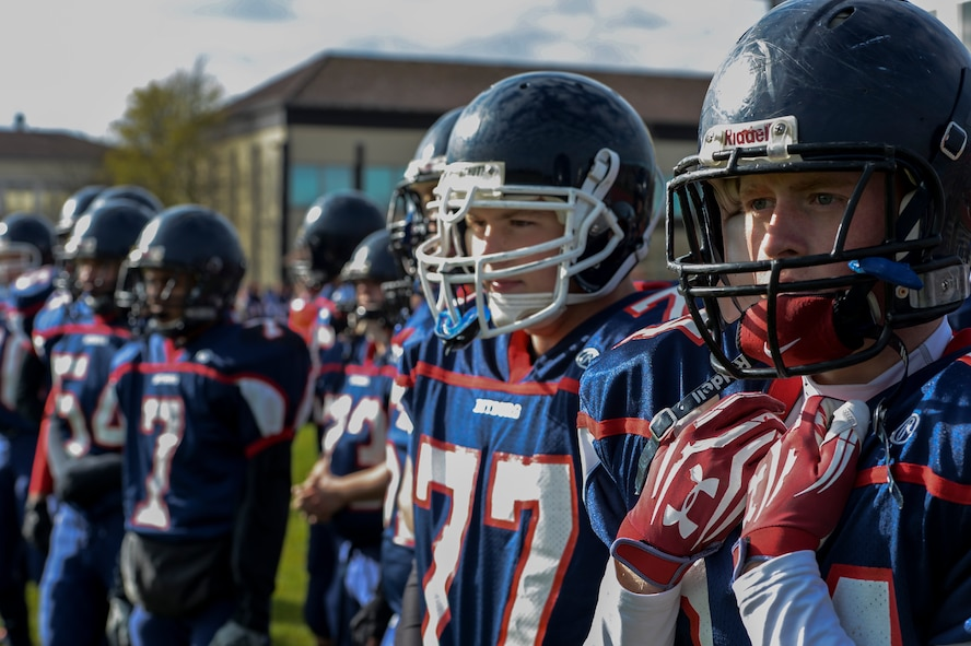 BITBURG ANNEX, Germany -- Ryan Hartwell, right, Bitburg Barons tight end from Panama City, Fla., looks on as his team defends the field against the Hohenfels Tigers Oct. 27, 2012, at Rik Carr Field. The Barons' won their final home game 56-14. The Barons play the championship game against the Naples Wildcats at Baumholder 2: 30 p.m., Nov. 3, 2012. The Wildcats and Barons are both undefeated. (U.S. Air Force photo by Senior Airman Natasha Stannard/Released)