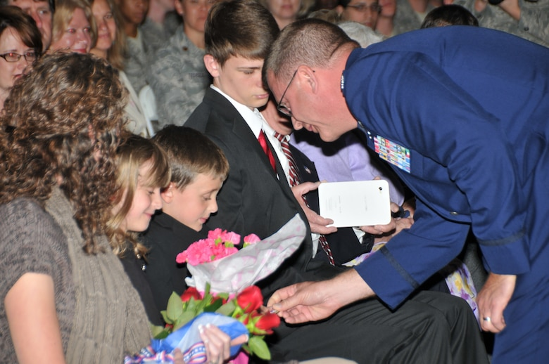 After accepting command for the 145th Airlift Wing during an Assumption of Command ceremony, Col. Roger E. Williams, Jr., thanks his wife Jena Williams for her continuous support, along with their daughter Danielle and sons Dane and Ryan, Col Williams' father, Roger E. Williams, Sr., his mother Lizzie and his sisters Ann and Peggy along with Peggy's husband Eddie and their sons Blayne and Hunter.  (National Guard photo by Tech. Sgt. Rich Kerner, 145th Public Affairs)