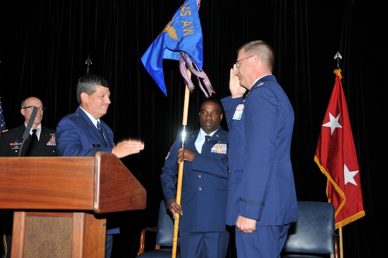 Maj. Gen. Gregory A. Lusk, The Adjutant General of the North Carolina National Guard presided over an assumption of command ceremony at the North Carolina Air National Guard base at Charlotte Douglas International Airport as Col. Roger E. Williams, Jr., took the reins of command for the 145th Airlift Wing, held for the last eight years by Brig. Gen. Tony E. McMillan.  Col. Williams accepts command from Brig Gen D. Todd  Kelly, Assistant Adjutant General - Air, North Carolina National Guard. Acting as First Sergeant, is the Wing Command Chief Master Sgt. Maurice Williams.  (National Guard photo by Tech. Sgt. Rich Kerner, 145th Public Affairs)