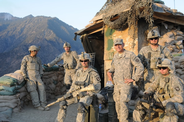 Captain Peter Shinn, an Officer Training School instructor, with Soldiers at Outpost Mace in Kunar Province, Afghanistan, Dec. 20, 2010. Shinn won an Emmy? for videography in Afghanistan. He was part of a team that put together Iowa Soldiers Remember Afghanistan, which aired on Iowa Public Television on Veterans Day in 2011. The program won the 2012 Emmy? for best Military Program in the Upper Midwest Region. (U.S. Army photo.)