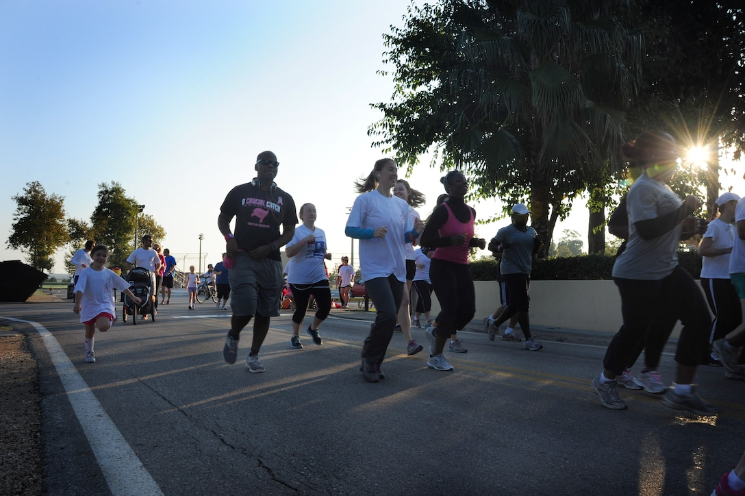 Airmen and family members participate in the Triple Ribbon 5k run Oct. 27, 2012, at Incirlik Air Base, Turkey. Approximately 70 members participated in the event, raising money for the Combined Federal Campaign. (U.S. Air Force photo by Senior Airman Anthony Sanchelli/Released)