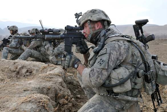 U.S. Army Sgt. Jonathan Sweetman, Bulldog Troop, White Platoon, 7th Squadron, 10th Cavalry Regiment, looks through his rifle scope to scan for insurgents during a reconnaissance patrol near Combat Outpost Delorean, Bala Murghab, Badghis Province, Afghanistan Jan. 9, 2011. Sweetman led one of the four fire teams on the patrol and all four teams came under accurate small-arms fire. (U.S. Air Force photo/Master Sgt. Kevin Wallace/RELEASED)