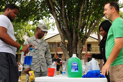 (Right) Staff Sgt. Christopher Cobb, 628th Medical Operations Squadron Air Force Alcohol and Drug Abuse Prevention and Treatment noncommissioned officer in charge, educates Airmen on the drinking laws during the 2012 Oktoberfest Oct. 26, 2012 at Joint Base Charleston - Air Base, S.C. Oktoberfest is an annual event put together by the First Six for ranks E-1 through E-6 to show appreciation for their day-to-day hard work. The event included free food and drinks, a disc jockey and a hot wing eating contest. Airmen also played games such as basketball and corn hole.