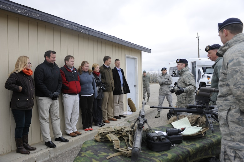 Members of the 91st Missile Security Forces Squadron, Tactical Response Force team, brief a group of congressional staff members on their mission duties in support of the deterrence mission here, Oct. 25. The congressional staff visit was aimed at better acquainting the group on the essentialness of the Team Minot mission.
